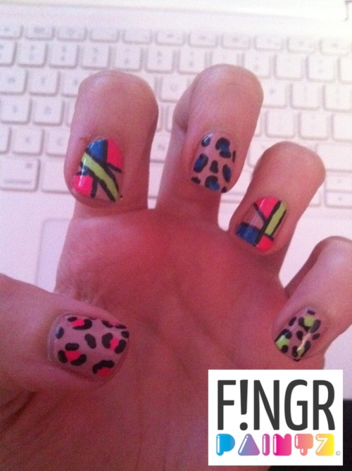 Hi people!  This nail art is inspired by my love for leopard nail art (who doesn't love a good leopard print nail?) and also my love for NEON!  I love shiny/bright things.  And living in the northeast with this dreary winter weather, bright colors is just what I need.  Background nude color is OPI Dulce de Leche.  Enjoy!! xxo Laur