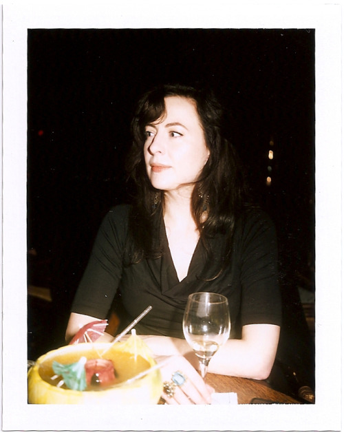 polaroidsf:  Jodi Lee at the Tonga Room (w/Lava Bowl). Just because Anthony Bourdain said so? A cover band playing Mom-jams of the 80's from a floating tiki island? Strong, expensive, sugar-laden drinks? So… why go here? To feel fancy, of course. And it rains in the bar. Thumbs up.  I love the Tonga room!