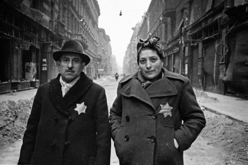 sovietjewry:   Evgenii Khaldei, Budapest Ghetto, 1945  A part of the Through Soviet Jewish Eyes: Photography, War, and the Holocaust exhibition at the CU Art Museum, based on David Shneer's book of the same name.  Most view the relationship of Jews to the Soviet Union through the lens of repression and silence. Focusing on an elite group of two dozen Soviet-Jewish photographers, including Arkady Shaykhet, Alexander Grinberg, Mark Markov-Grinberg, Evgenii Khaldei, Dmitrii Baltermants, and Max Alpert, Through Soviet Jewish Eyes presents a different picture. These artists participated in a social project they believed in and with which they were emotionally and intellectually invested—they were charged by the Stalinist state to tell the visual story of the unprecedented horror we now call the Holocaust. These wartime photographers were the first liberators to bear witness with cameras to Nazi atrocities, three years before Americans arrived at Buchenwald and Dachau.Through Soviet Jewish Eyes helps us understand why so many Jews flocked to Soviet photography; what their lives and work looked like during the rise of Stalinism, during and then after the war; and why Jews were the ones charged with documenting the Soviet experiment and then its near destruction at the hands of the Nazis.   Reblogging because the curated exhibition Through Soviet Eyes: Photography, War, and the Holocaust is coming to New York! Professor David Shneer will be attending the exhibition's opening at the New York Museum of Jewish Heritage on November 15, 6-8pm (event info). Register by November 7. The critically acclaimed exhibition will run from November 16, 2012 - April 7, 2013.