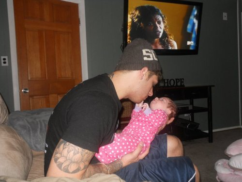 "mariahtheportagiee:  okay so this is my brother Zackary & his daughter Kira, you might be wondering why i'm posting a picture of them on my tumblr. well the thing is my brother passed away a little over a year ago on december 18th, 2010. his daughter was only a month old when he passed away. well now you might be wondering how he died. so him & his girlfriend got into a fight & he left out of rage & ended up going to a club with his friend & got drunk. when him & his friend were leaving they ended up getting into a fight with these 3 guys, while his friend was fighting 2 of the guys, the guys stopped & pointed to my brother & said ""hey look at your friend"" & when my brothers friend looked over my brother was holding his stomach & was bleeding. one of the guys stabbed him several times 2 fatal to the heart. my brother managed to walk to his car which was less than 30 feet away from where he was stabbed & thats where he fell. by the time the ambulence came it was too late & the 3 killers ran away & the killers are still unknown. my brother was only 22 he still had many years ahead of him. my brother always wanted to be famous, maybe not tumblr famous but  if you're reading this can you please just reblog this for him. I will NEVER be as close to anyone as i was with him. NEVER FORGOTTEN ZACKARY JOSEPH MARSHALL 5.27.1988-12.18.2010"