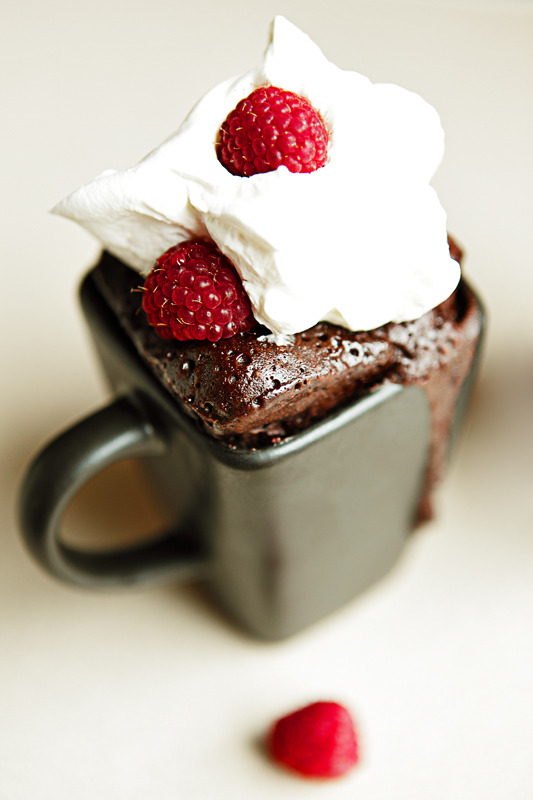 mandyashcraft:  The Most Dangerous Chocolate Cake. Just For one. Ingredient of the day: Nutella There are few things that can be made with 8 total minutes of time, including cook time, with minimal cleanup. Fortunately, this beautiful dessert is one of them! Thanks to The Novice Housewife, who did it with strawberries, for this idea. Nutella Espresso Mug Cake with Fresh Raspberries 4 tbsp flour 3 tbsp sugar 1 tsp espresso powder or instant coffee (I used Starbucks VIA Extra Bold) 1 egg 3 tbsp cocoa powder 3 tbsp Nutella 3 tbsp milk 2 tbsp vegetable oil Pinch of salt Whipped cream Fresh raspberries (or strawberries, blueberries, etc) 1. In a regular sized coffee mug (10oz), add egg and whisk lightly with a fork. Add milk, salt, espresso powder, sugar, cocoa, and oil to the mug. Mix well. 2. Add the Nutella and mix very well. 3. Fold the flour in carefully with a fork. Be careful not to overmix, to ensure a smooth fluffy texture. 4. Microwave on high for 3 minutes. 5. Allow to cool, and top with whipped cream and raspberries. Photo by Dustin Ashcraft.