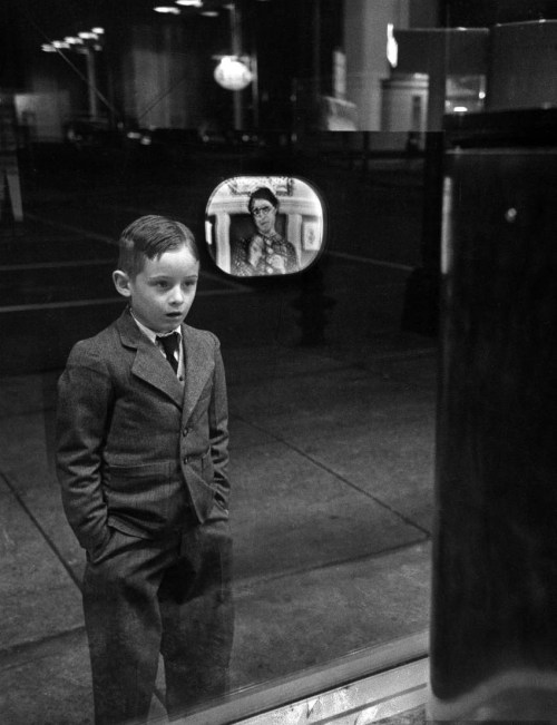 Erie indeed legrandcirque:  Boy watching TV on store window set, with the glass reflecting the TV screen. Photograph by Ralph Morse. Erie, Pennsylvania, USA, March 1949.