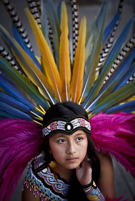 "thinkmexican:  11 Year-Old Carries On Family's Aztec Dance Tradition San Francisco Mission District resident Connie Xochiquetzalli ""Xochi"" Peña has been an Aztec dancer all her life. As a 2 year-old, she danced an entire parade route. Now 11, Xochi sometimes steps in for her mother and teaches dance class at the Mission Cultural Center. She comes from a long line of Aztec dancers. Her great-grandfather on her mother's side was also a dancer in her family's native Toluca, Estado de Mexico. Xochi has big plans for herself, ones that include practicing either law or medicine. If dancing parade routes as a toddler and teacher classes while still in the sixth grade is any indication, we're sure she can do anything she sets her mind to. via SF Gate Photo: Rod Yip/The Chronicle"