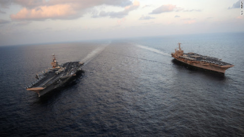 "kileyrae:  (CNN) After Iran threat, U.S. aircraft carrier goes through Strait of Hormuz flanked by British and French ships without incident.  As far as I'm aware, an American ""Carrier Battle Group"" is the most powerful military formation ever. All it needs is one nuclear powered Aircraft Carrier and the various escort and support ships to move into an area to make a heavy security presence and play the Clausewitzian game of power.  And the US has, to my knowledge, 7 of these on patrol around the world.  France had two, the UK had one. That's before the cutting of the defense budget last year, and now the plan is to ""share"" one carrier between them. I think that's still in process. It's been a while, I forgot.  But America still has 7."