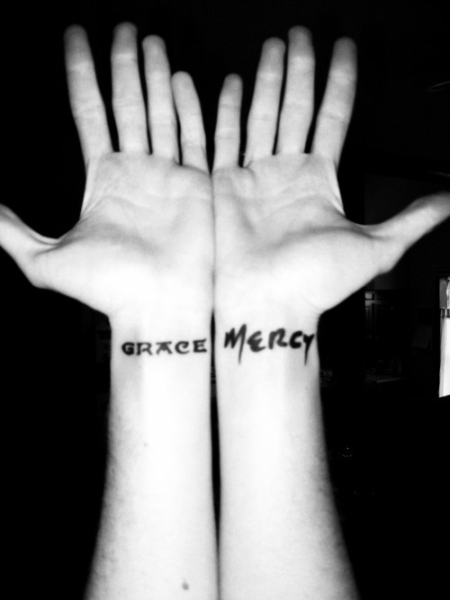 "OURS and Jeff Buckley tattoos. ""Grace"" and ""Mercy"" my two favorite albums. Ink by Nick Fabini of Cardinal Tattoo in Ft. Wayne Indiana."