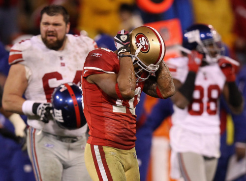 """Williams the loneliest 49er after two turnovers"" By Les Carpenter, Yahoo! Sports SAN FRANCISCO – After the disaster, Kyle Williams dressed alone… <snip>  … his eyes focused on nothing. He pulled on a White Sox cap and blue-hooded sweater, draped the hood over his head and quickly walked out of the locker room, into a tunnel filled with delirious Giants players, family members and eventually into the parking lot where he blended in with the fans and disappeared…  Photo by Ezra Shaw/Getty Images"