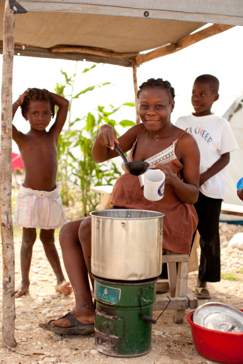 Our favorite barista in Haiti, Vivian Cola, uses her charcoal-efficient stove to sell coffee in her tent camp. Learn more at www.theadventureproject.org.