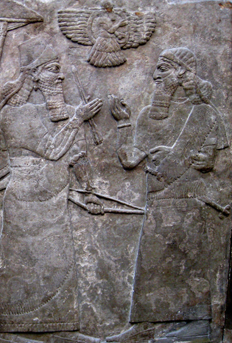 tammuz:  Assyrian King Ashur-nasir-pal II meets a high official during a review of soldiers and war prisoners. From the North-West Palace at Nimrud. The British Museum, London, UK.