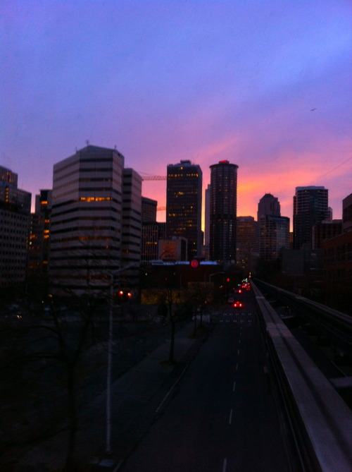 Sunrise over downtown Seattle from the Seattle Monorail. Photo by Megan Ching