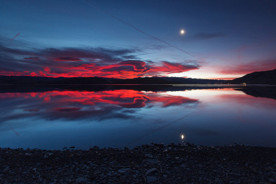 Sunrise Storm and Moon Rise Reflection by Jeffrey Sullivan on Flickr.