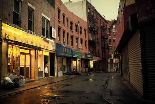 "Rainy  Doyers street in Chinatown. New York City.  When the sky seduces the city with its tears of happiness, the streets swoon illuminated by the glow of nearby lights.    Broken-hearted alleys fill up: lovers with empty recesses in their hearts soak in the warm afterglow of what the sky has wrought.    —-  View this photo larger and on black on my Google Plus page  —-  Buy ""The Seduction of the Sky - Doyers Street - Chinatown - NYC"" Posters and Prints here, View my store, email me, or ask for help."