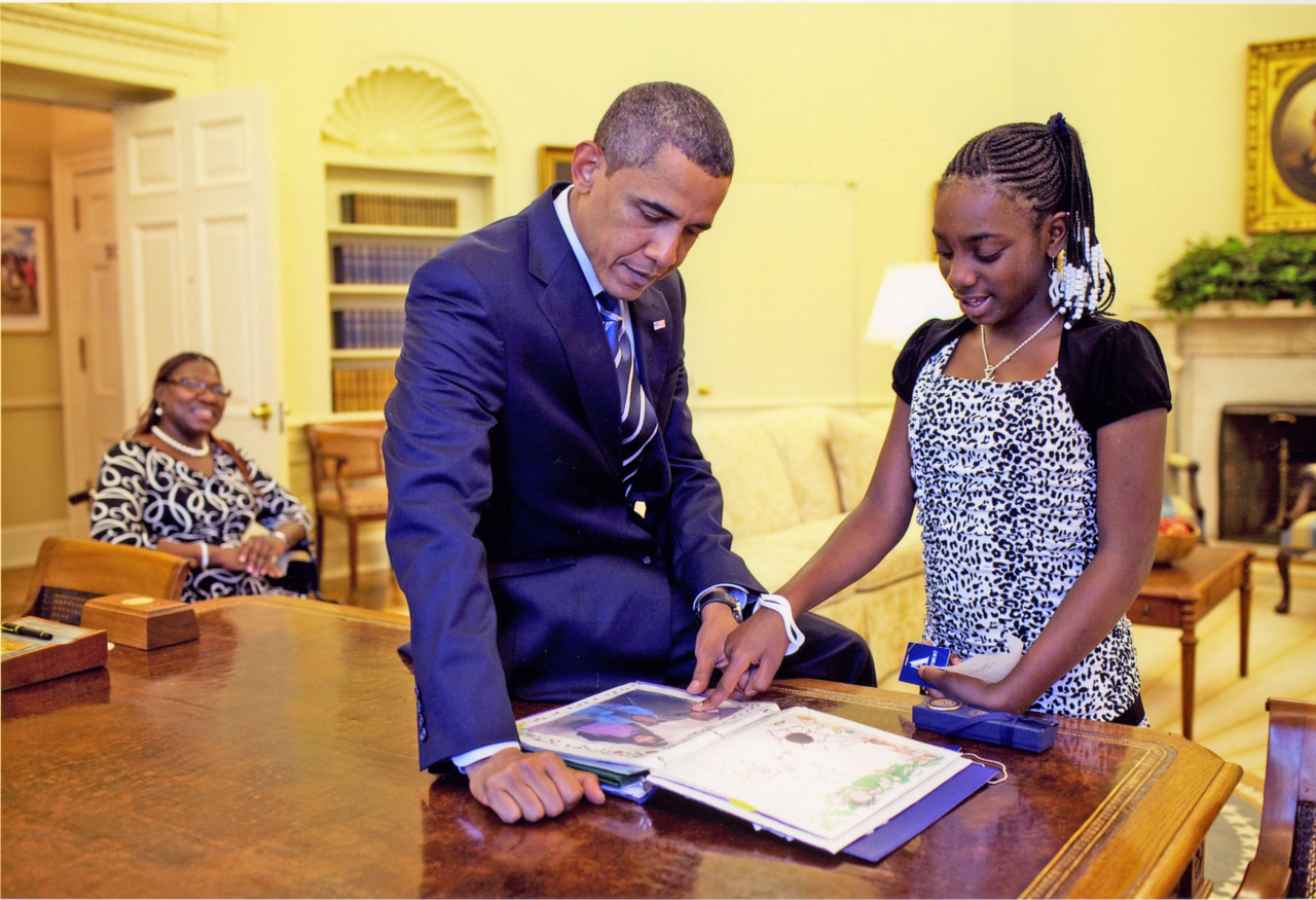 kidswishnetwork:  President Barack Obama will be delivering his third State of the Union address this Tuesday evening and, as an attempt to incorporate and further engage the public, he will be answering questions submitted through the White House YouTube.com channel. From today until Saturday, January 28th YOU will have the chance to submit a question and/or vote for your favorite. Then, on Monday, January 30th, President Obama will join in a Google + Hangout, participating in a live discussion. This is a pretty cool move on President Obama's part. He has always professed to be on the side of the people… and in one special case… he proved it. With the help of Kids Wish Network, he honored 12-year-old Ta'Kiyah with her very own wish-come-true! In 2007, after several complaints of headaches, Ta'Kiyah's doctors discovered a malignant tumor on her brain. She spent over six months in the hospital, where she underwent chemotherapy that made her very ill and caused her to miss most of her school year.  President Obama took the time to speak with her and admire the scrapbook she brought him of her photos, special certificates, and report cards.  He carefully looked through the whole scrapbook with her asking her what each photo represented. What a great guy, huh? To tune into the State of the Union live visit: YouTube.com/whitehouse or on WhiteHouse.gov/sotu To donate to Kids Wish Network and help grant even more wishes to deserving children like Ta'Kiyah visit: http://kidswishnetwork.org/ways-to-help/donate-money/ Or, to refer a child to our program visit: http://kidswishnetwork.org/wishes/refer-a-child/