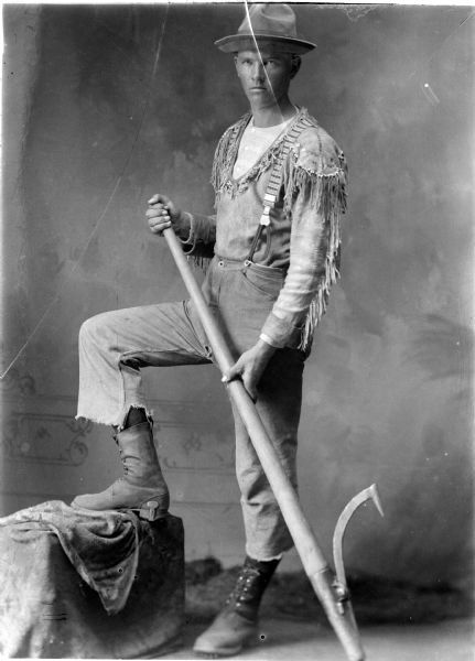 Studio portrait of a young lumberjack, Black River Falls, Wisconsin. This unidentified logger holds a peavey—the iconic tool of the lumberjack, used to grab, roll and otherwise move a log. Photo by Charles van Schaick. via: Wisconsin Historical Images WHi-46149, Wisconsin Historical Society.