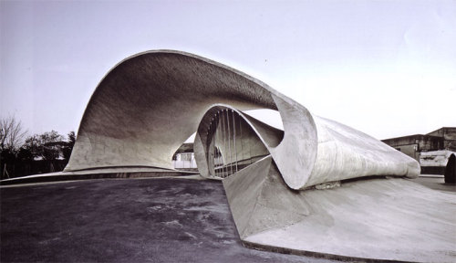 """Designed by architect Justo Garcia Rubio, Casar de Cáceres bus station is an interpretation then combination of place and tradition. The bus station is located on the children's way to school which defines its shape as a large loop to evoke the world of children's dreams. The construction follows the region's tradition of using one single material for all the building's elements, in this case, it is a sheet of white concrete, which leads to the special structure, roof and spatial limits of the new transport station"""