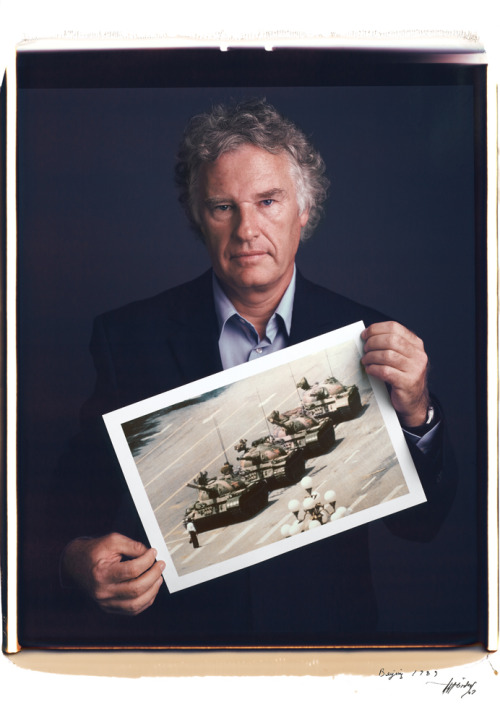 Famous photographers pose with their most iconic pictures. It's great giving these people some recognition, as we often remember the photograph, and the photograph only. Makes you realize that beautiful simplicity in talent - in that it is nothing more than passion meets luck.  Pictured above is Jeff Widener holding his famous photo of 'Tank Man in Tienanmen Square' from 1989. View more here.