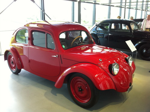 "vwkombi:  the first Volkswagen concept car on show at the Volkswagen museum in Wolfsburg; in the back the first production model to compare. eg the concept didn't have running boards or a rear window, and it featured ""suicide doors"", which open forward. the name ""beetle"" came much later, so I won't use it…"
