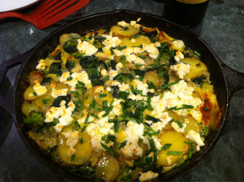 Dinner! Frittata made with organic produce from my Bountiful Baskets co-op. New potatoes, broccoli, spinach, yellow onion, garlic, yard eggs and topped with goat cheese and chives from my garden. Yum!