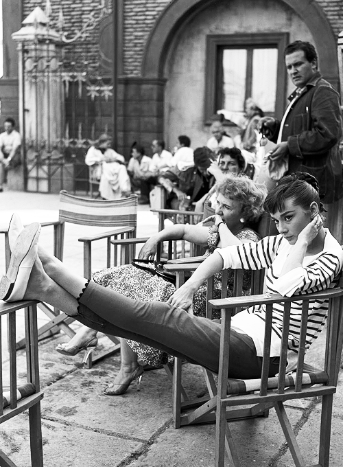 missavagardner:  Audrey Hepburn takes a break on the set of 'Roman Holiday',1953.