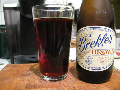Beer: Brekle's Brown Brewery: Anchor Brewing CompanyLocation: San Francisco, CAType: Brown ale In Three Words: malty, nutty, bold Once again, Anchor has produced a beer that I really love and can't get enough of. After touring Anchor Brewery a couple weeks ago (still be to be posted about), I had to grab a bottle of this signature beer they just came out with in honor of one of their original master brewers (who was named Gottlieb Brekle). He started the brewery way back in 1871. This beer is in honor of the 140 years of brewing tradition the brewery has undergone (phew, that's a lot). The beer is dark when you pour it with a soft brown color; pretty much exactly how it tastes if I was one of those people who can taste colors (I forget, is that a thing?) It's strong without being overpowering and has a smooth malty, almost creamy, flavor that rolls over your tongue perfectly. The darkness of the beer comes through in the little twinge you get in the corners of your mouth from the hops that have been balanced out to a tee with the malts. They exist in a yin-yang relationship in this glass of beer that comes straight out of the bottle. Definitely hoppier than your average brown ale, I think that is precisely what gives this beer it's original and snappy taste. The bitterness that comes through is accentuated by a sweetness that I can't quite place (maybe a chocolate?) but only allows for the brown ale malt to act as the counter to that. Together they make for a really authentic yet all around distinctive take on the traditional brown ale.