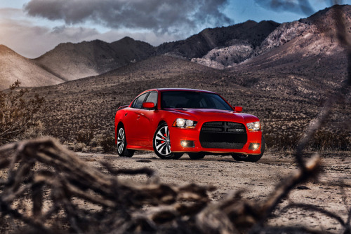 2012 Dodge Charger SRT8.  6.4 Liter HEMI 8 cylinder engine.  465 hp at 6,000 rpm.  465 lb-ft at 4,300 rpm.  24 highway mpg, and 19 combined mpg.  0 to 60 mph in 4.6 seconds.  Two mode adaptive suspension.  0 to 100 mph in 11 seconds.  Chrysler's Fuel Saver Technology can turn the eight cylinder engine into a four cylinder to conserve energy when possible.  Standard Sport mode.  Image courtesy of Dodge Autos on Flickr.