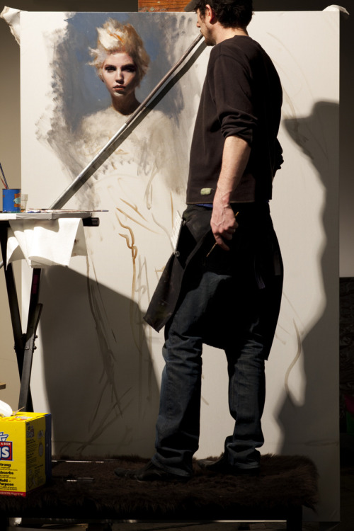 "I had to stand on a table for this one. At work on ""In Umber"" 50x80 oil on canvas."