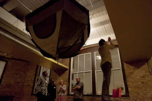 Occupy Chicago's indoor headquarters  Putting up a tent installation