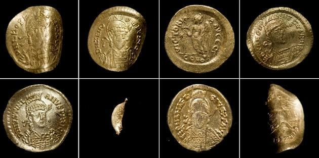 Eight 6th century gold coins discovered in a potato field near Biesenbrow in Uckermark, northeast Germany.   The treasure is composed of seven Byzantine solidi and an extremely rare coin bearing an image of the Merovingian King Theudebert I (reigned 533-548 A.D.). The coins are thin and bent, weighing around 4.4 grams each. The standard weight of solidi was 4.5 grams, so despite their bent and curled appearance, they've managed to stay remarkably intact. - thehistoryblog.