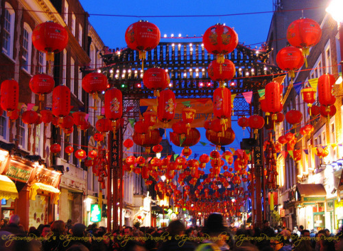 Happy Chinese New Year ~ on Flickr.Hundreds of red lanterns dance above revellers in London's Gerrard Street, Chinatown, during the Chinese New Year festivities in 2008. May the Year of the Dragon bring you much luck !