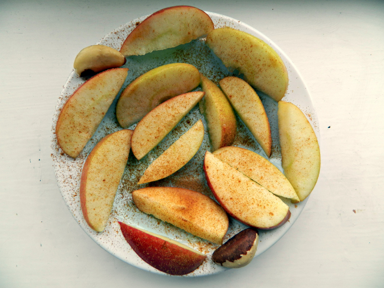 A chopped up braeburn apple with lemon juice, cinnamon and two Brazil nuts. I've recently stopped taking my multi-vitamin as my vitamin and mineral levels were perfectly healthy anyway! However I was a little low on selenium, hence the Brazils. 1oz of Brazil nuts contains 777% of your daily requirement! So two a day should be the limit, to not OD on selenium. :)