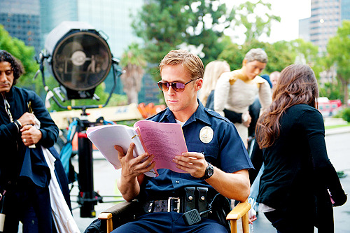 fuckyeahfilmsets:  Ryan Gosling reading his script on the set of Drive.