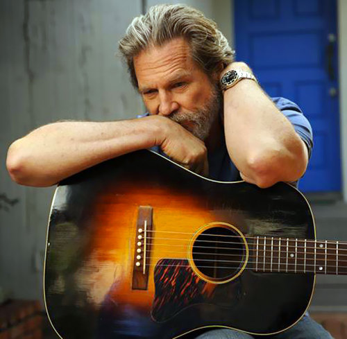 Jeff Bridges, his guitar and his Rolex.