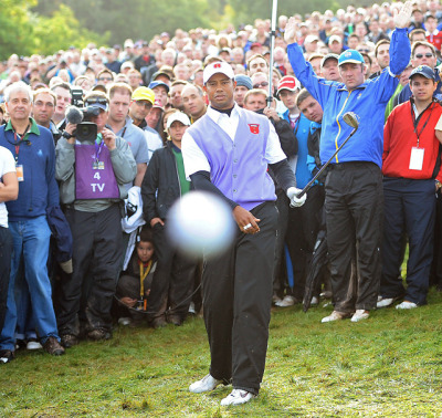 siphotos:  Tiger Woods attempts to hit out of the rough, but instead hits Daily Mail photographer Mark Pain's camera with the ball on the final hole of the 2010 Ryder Cup. (Mark Pain/Mail on Sunday/ZUMA Press)