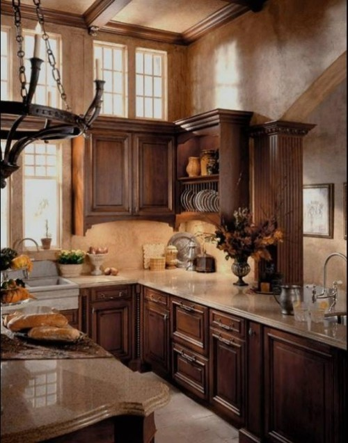 A beautiful and classic European-style kitchen with wood cabinets and granite countertops (via Graniterra)