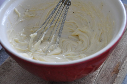 "No. 10: Mayonnaise - 24.1.12  I was quite worried about this recipe because I know how easily it can go wrong! But so many times have I heard that you must be fearless in the kitchen! ""Anyone can cook but only the fearless can be great!"" - Ratatouille. So I said to myself, go for it. I looked at a few different recipes for it but I decided to go for one from ""Gizzi's Kitchen Magic"" as it used a mixture of vegetable oil and olive oil!  2 free range egg yolkssalt and pepper1 tsp Dijon mustard 1/4 tsp White wine vinegar150ml Olive Oil150ml Vegetable Oil This recipe states you must use a food processor, which would make it so much quicker to do. However! Every single time I have seen the recipe being made on tv they always state to ALWAYS use a wire hand whisk! I stuck to my guns and whisked this by hand! - Whisk the egg yolks, salt, pepper, mustard and vinegar together in a large bowl. - In a jug, combine the 2 oils together and then very slowly add to the egg yolk mix! 1 teaspoon at a time, whisking thoroughly in between each addition until half of the oil mix has been used up. It should be quite thick by this point!-  Pour the rest of the oil in a thin steam, continually whisking to make sure it doesn't split. I got quite worried at this point and did it a little at a time because I reaalllyyy didn't want it to split! When combined it will be thick and wobbly- Season to taste with salt, pepper and a dash of vinegar.  It should keep for about a week in the fridge in a sealed container :) I was so so proud of myself. It tasted so good!!! I thought it would go completely wrong, split and be greasy. It was smooth, creamy and you got these lovely subtle hints of the mustard and vinegar coming through. It was delicious! I had it with new potatoes, tuna and red onion for my lunch :) I don't think anything in the world can be more satisfying than making your own mayonnaise."