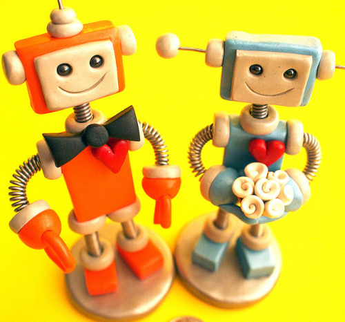 "Robot Wedding Cake Topper Orange and Blue Bots on Flickr.Robot Wedding Cake Topper. The wee robot groom is orange with silver accents and the robot bride in light blue with silver accents and white bouquet. Groom is 6"" inches antenna to base. Bride is 5"" inches antennas to base. [Claim them here]"