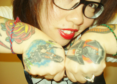 A Little Bit On The Tattooed Side: Lili Haggerty's X-Wing vs Tie Fighter hand tattoos are making me want for more geeky ink on my sexy bod.