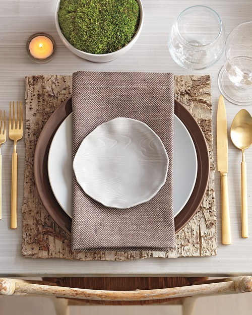 The science of texture on a place setting: Natural rough wood, smooth matte plateware, soft patterned linen, muted and complimentary texture.
