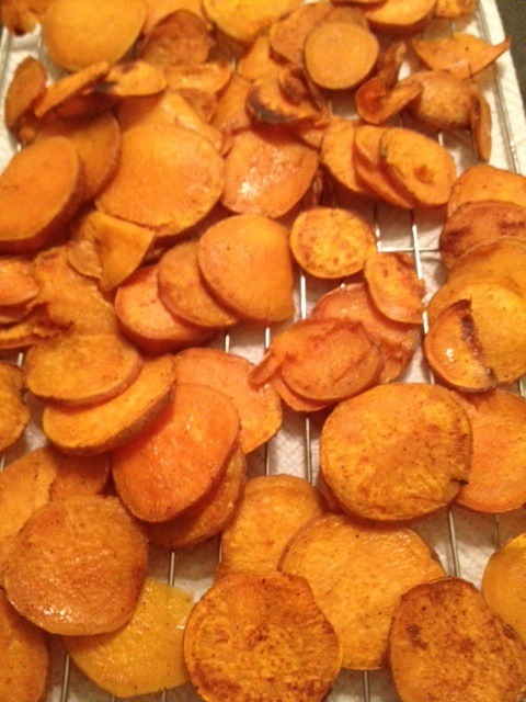 2 (medium) sweet potatoes, scrubbed clean and sliced into 1/8-inch slices  2 tablespoons vegetable oil  1/2 teaspoon salt  1/4 teaspoon pepper  1/4 teaspoon garlic powder  1/4 teaspoon cumin  1/4 teaspoon cayenne pepper  1/4 teaspoon nutmeg  1/4 teaspoon paprika   1. Preheat oven to 400 degrees F. 2. Place sweet potato slices and oil in a re-sealable bag and shake to coat. 3. In a small dish, combine the seasonings and add to the sweet potatoes. Shake again to evenly coat. 4. Lay potato slices on a foil-lined baking sheet, and bake for 12-14 minutes. Remove the potatoes from the oven and flip.  Cook for an additional 10 minutes until crisp.
