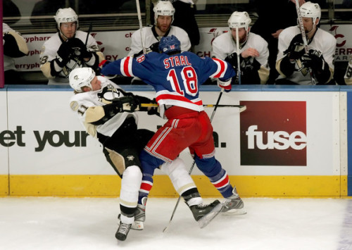 Marc Staal #18 of the New York Rangers taking out his younger brother #11 Jordan Staal of the Pittsburgh Penguins