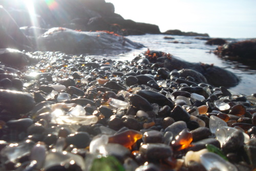 "so I was on Tumblr [of all places] and I found a post on glass beach…I thought to myself, I must go there sometime this lifetime. Talked to a friend about it and it ends up it was only 2 hours away! Here are some pictures I took and a brief history. ""In the early 20th century, Fort Bragg residents threw their household garbage over the cliffs above what is now Glass Beach. They discarded glass, appliances, and even cars. The land was owned at that time by the Union Lumber Company, and locals referred to it as ""The Dumps."" Sometimes fires were lit to reduce the size of the trash pile….Over the next several decades the pounding waves cleansed the beach, wearing down the discarded glass into the small, smooth, colored trinkets that cover the beach today."" (check out my adventures!)"