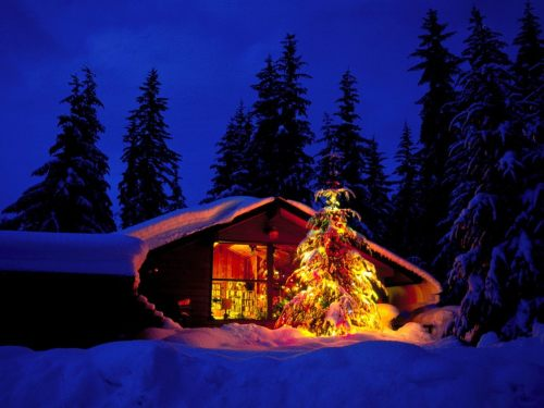 Christmas cabin in deep snow