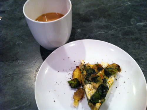 Breakfast. Leftover frittata with new potatoes, spinach, broccoli and goat cheese. And coffee. It's a rainy day. I'm writing this from the elliptical before Bodypump.