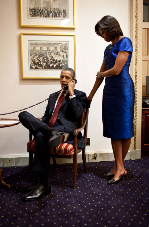 obamafamily:  In a phone call from the U.S. Capitol immediately after the State of the Union Address, President Barack Obama informs John Buchanan that his daughter Jessica was rescued by U.S. Special Operations Forces in Somalia, Jan. 24, 2012. First Lady Michelle Obama stands behind the President. (Official White House Photo by Pete Souza)