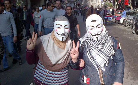 fotojournalismus:  Women in Cairo wear V for Vendetta masks that have become a global symbol of resistance. Many of the protesters are wearing masks of those who died in the Maspero violence last year- Khaled Saeed, Azhar scholar Emad Effat, Salafi Sayed Bilal and Mina Daniel, in Tahrir Square, Cairo, on Jan. 25, 2012, marking the first anniversary of the uprising that toppled Hosni Mubarak.  [Credit : Guardian]