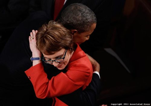 paid2see:  AP Photographer Evan Vucci caught his very nice simple moment last night before the State of the Union address as President Barack Obama hugs Rep. Gabrielle Giffords, D-Ariz. Vucci was in a an elevated position looking down on the House floor which allowed him to keep the frame clean in a very crowded room. Rep. Giffords resigned from Congress today to concentrate on her recovery from a gun shot wound to her head, The image was made with a Canon EOS-1D Mark IV with a 70-200mm zoom lens set at 123mm. The exposure was 1/250 @ f2.8 rated at 800iso.