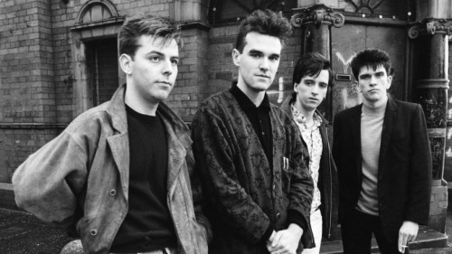 "Ed Ward reviews The Smiths' Complete Works: Smiths phrases turn up everywhere, from the ""meat is murder"" meme to Douglas Coupland's novel Girlfriend in a Coma, which is a Smiths song, to a poster for a club event this past weekend which I saw emblazoned with the words ""Hang the DJ."" The Smiths are dead. Long live The Smiths."