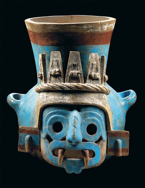 homoarchaeologicus:  Aztec god Tlaloc ceramic face pot, Templo Mayor, Mexico. Between between AD 1325-1521.  The pre-Hispanic people conceived of Tlaloc's face as being formed by two intertwined snakes which come together around the nose and mouth. Here the snakes can be seen from the alternating vertical lines and circles that make up the eyebrows, eyes, and nose, as well as around the mouth.