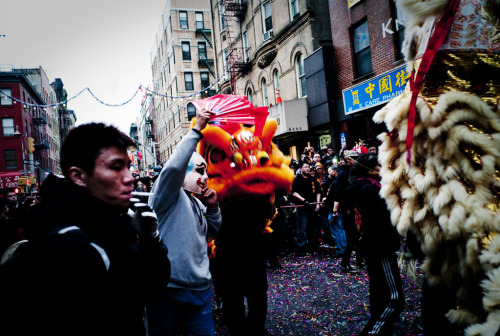 A Lion Dance is performed in NYC's Chinatown. Photo by Hai Zhang (one of the artists featured in our upcoming photography show America through a Chinese Lens.)