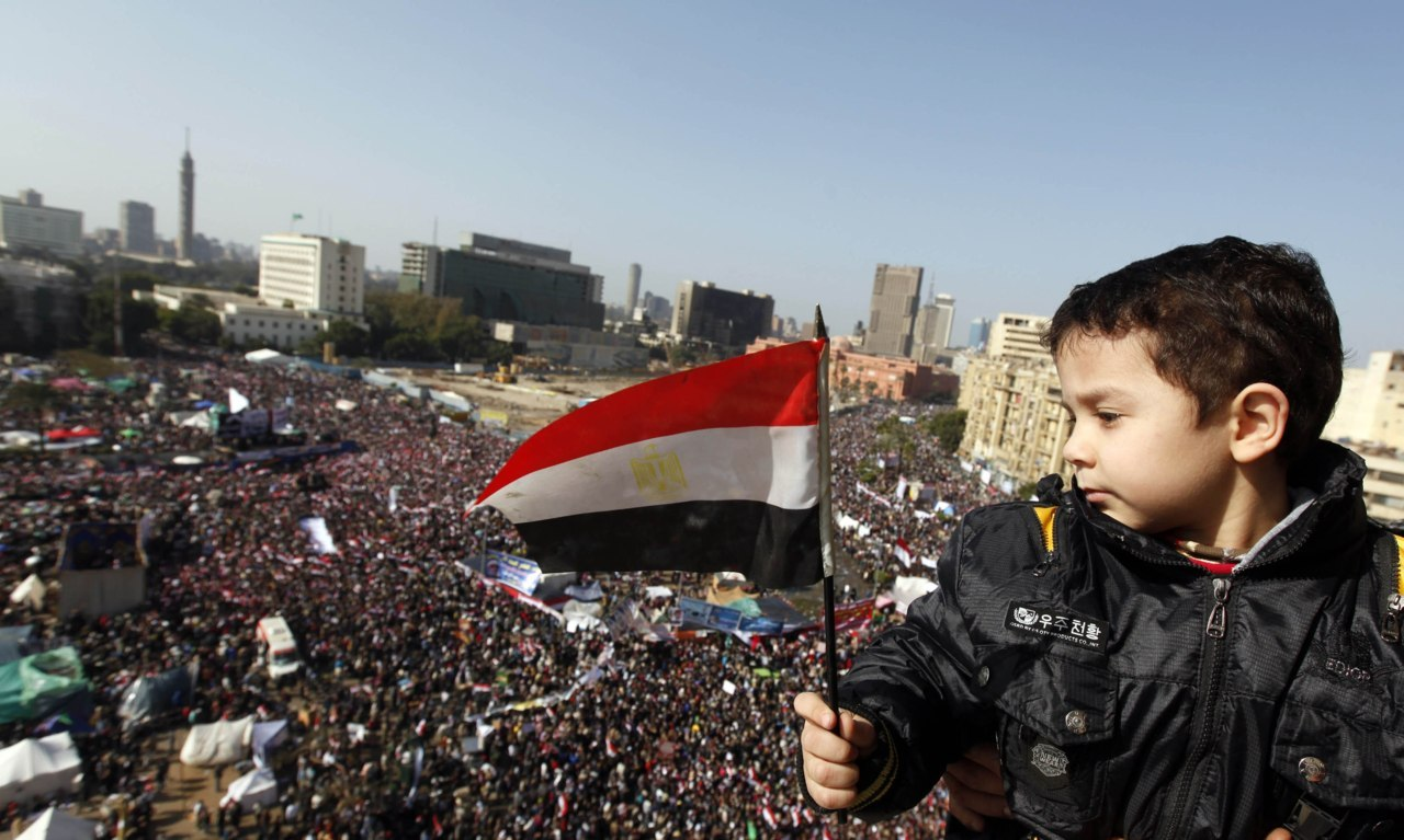 A boy holds an Egyptian flag during a protest marking the first anniversary of Egypt's uprising at Tahrir square during in Cairo January 25, 2012. [REUTERS/Mohamed Abd El-Ghany] Read: Rift on show a year after Egypt's uprising