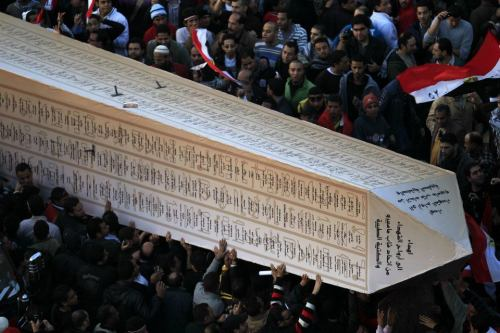 fuckyeahmarxismleninism:  Egyptian protesters hold up an obelisk with the names of those killed during last year's uprising, at a huge rally in Tahrir Square on January 25, 2012, marking the first anniversary of the uprising that toppled Hosni Mubarak.